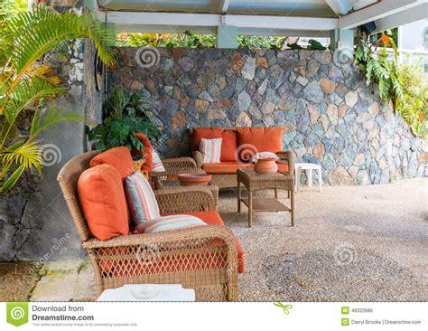 patio furniture with orange cushion stock photo image