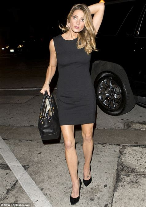 black and white handbag greene shows fit physique and legs in