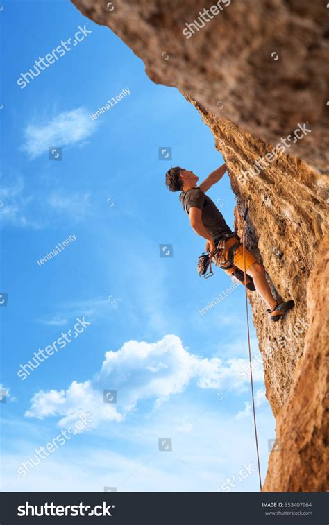 Male Rock Climber Wall Against Stock Photo