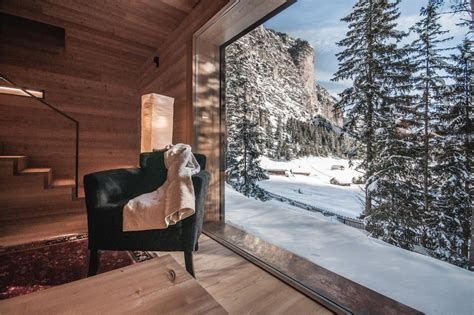 alpine lodge completely wrapped  wood    modern