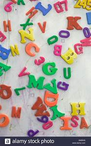 mixed up magnetic numbers and letters on a magnetic board With magnetic letters and numbers and board