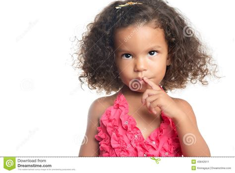 portrait of a little girl with an afro hairstyle stock