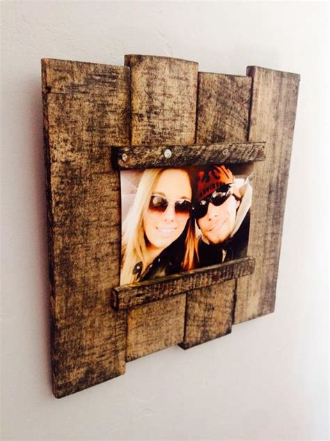 items similar  reclaimed wood pallet picture frame  etsy