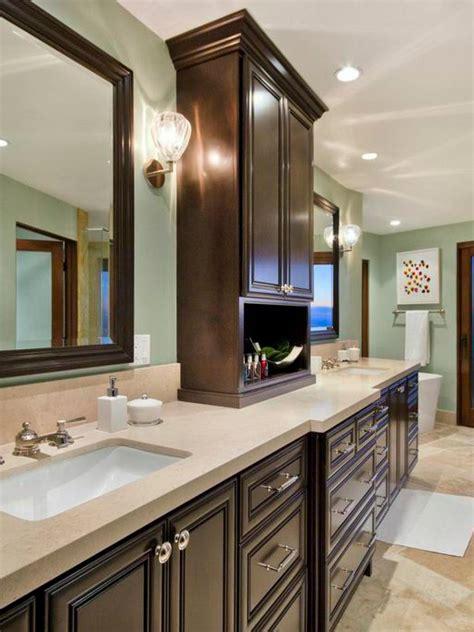 pale blue traditional master bathroom  dark cabinets