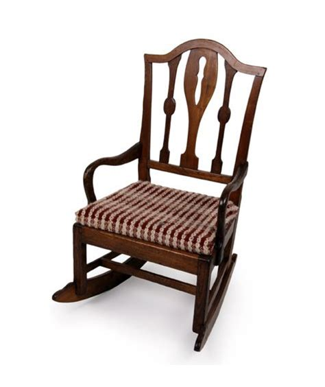 a 19th century elm rocking chair pierced and
