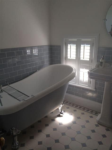 grey  white bathroom painted roll top bath