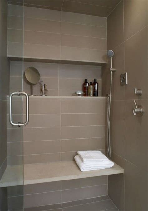 this modern shower niche uses simple linear tile framed