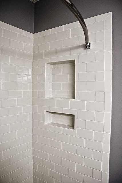 white subway tile shower niche with bullnose edge tile