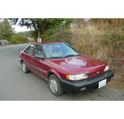 OLD PARKED CARS 1991 Geo PRIZM