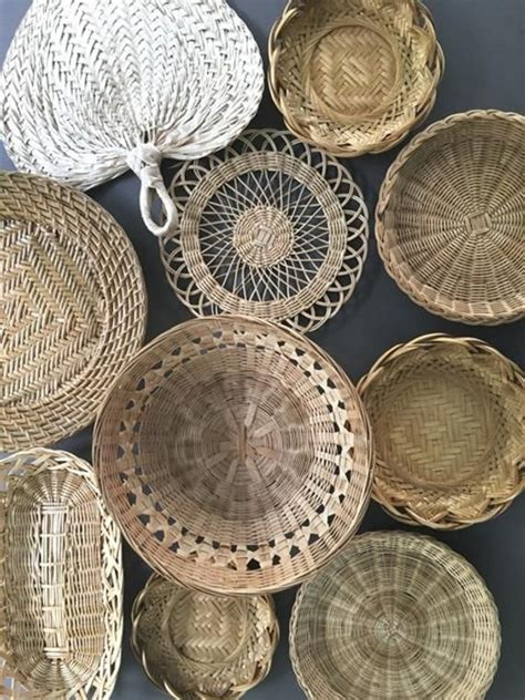 We all love gallery walls, and it's not hard to see why. A Gathering Of Baskets Boho Basket Wall Decor 9 Bohemian Decor 1970s Style | Baskets on wall ...
