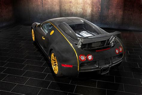 The mansory linea vincero d'oro version of the bugatti veyron adds a carbon fiber aerodynamics kit and gold details on the grille, the tires, the door handles and gas tank. Mansory Bugatti Veyron Linea Vincero d'Oro - Exclusive Luxury Vehicles - Autoblogzine