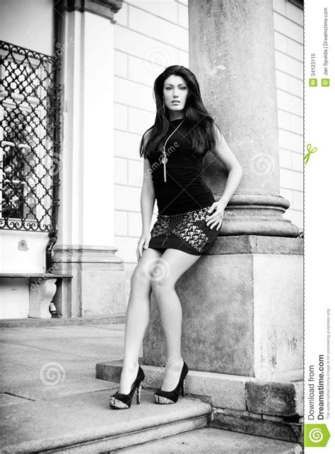 Beautiful Brunette Near A Building Royalty Free Stock Photo Image