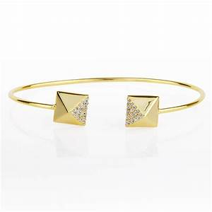 Ingenious gold adjustable bangle with pyramid ends ...