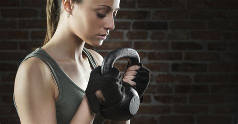 kettlebell exercises dumbbell woman use getty training livestrong using onmeda kettle fitness jupiterimages istockphoto