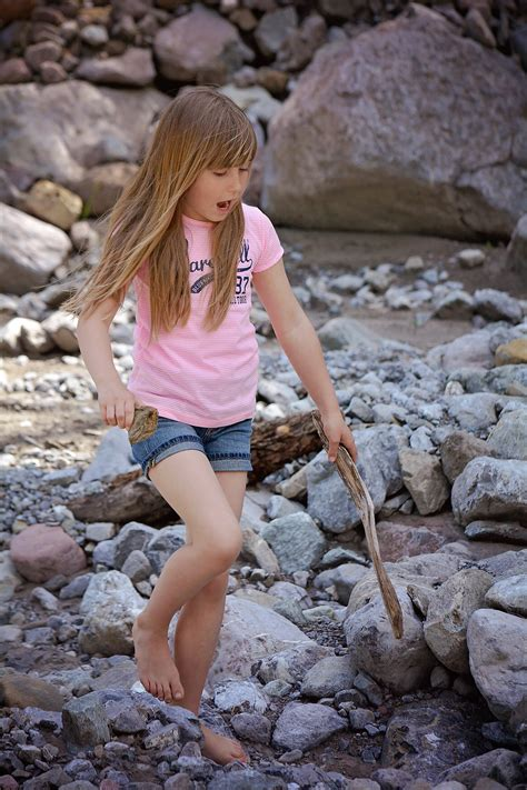 girl  long hair   rocks   pond