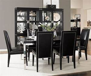Simple-dining-room-with-black-table-and-black-chairs-with