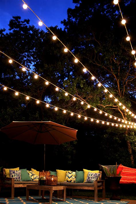 Backyard Lights by A Canopy Of String Lights In Our Backyard Gray House Studio