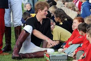 Prince Harry charmed local children after competing in a ...