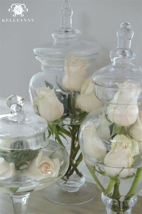 Bathroom Apothecary Jar Ideas by Flowers In Apothecary Jars House And Home In 2019