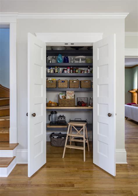 double doors open   reveal kitchen pantry terra