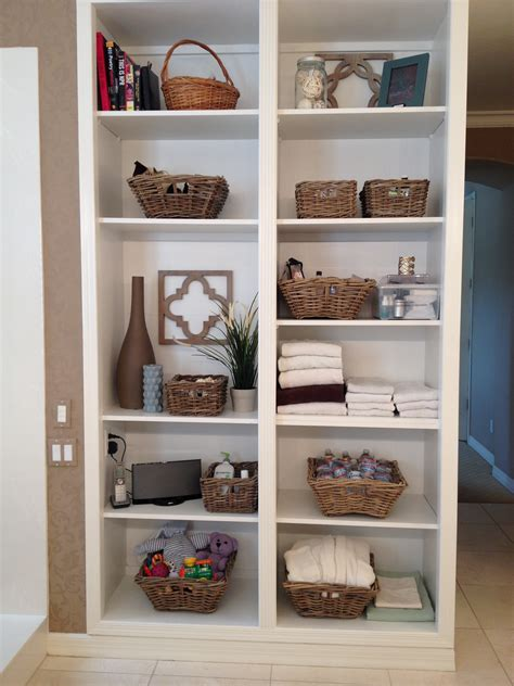 Decorating Bookshelves With Baskets by Charming Storage Shelves With Rattan Baskets For Organize