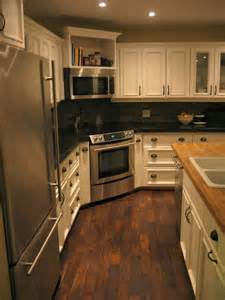White Kitchen Black Appliances with Stainless Steel