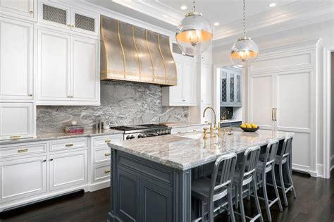 dark gray kitchen cabinets  brass pulls transitional