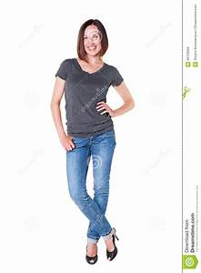 Happy Woman In Grey T-shirt And Blue Jeans Stock Photo - Image of shirt satisfied 26703084