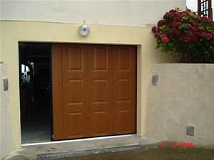 les portes coulissantes une solution tres pratique With isolation porte de garage coulissante