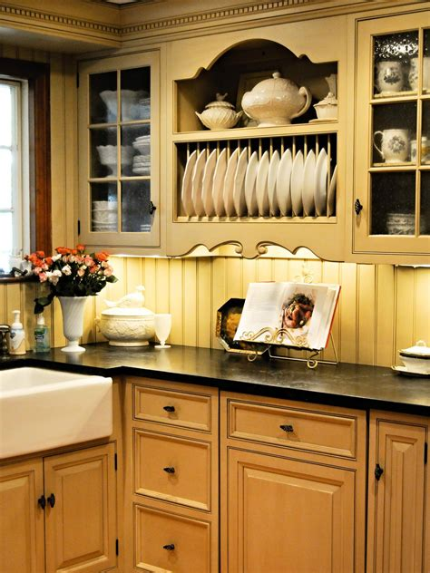 country beadboard kitchen cabinets country style kitchen cabinetry with beadboard backsplash