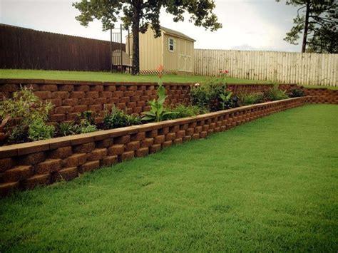 backyard retaining wall backyard retaining wall and flower bed all diy sloped yards pinterest backyards flower