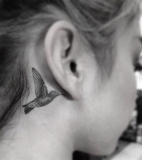sara hylands    ear hummingbird tattoo