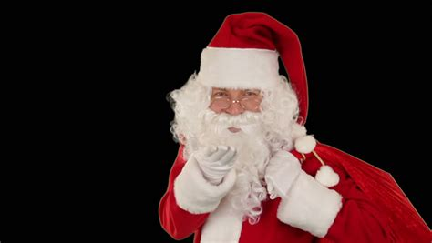 close up of santa blowing snow isolated against black