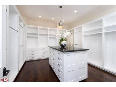 closet dark wood floors white paneling island