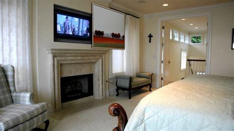 hidden tv  master bedroom traditional bedroom san
