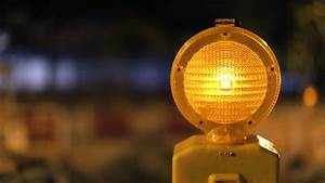 A caution sign is lit up by a blinking yellow warning for Lamp light blinking on jvc