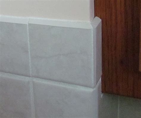 vertical miter cuts in ceramic tile trim using a