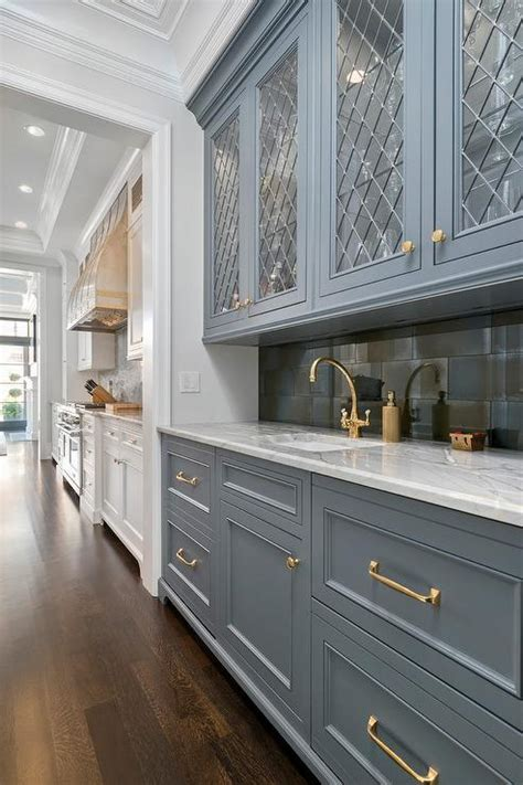 light grey kitchen cabinets with gold hardware gray bar cabinets with gold pulls transitional
