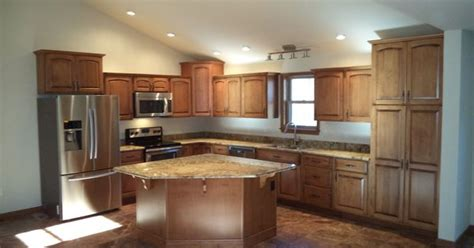 maple cabinets with honey finish and granite countertops