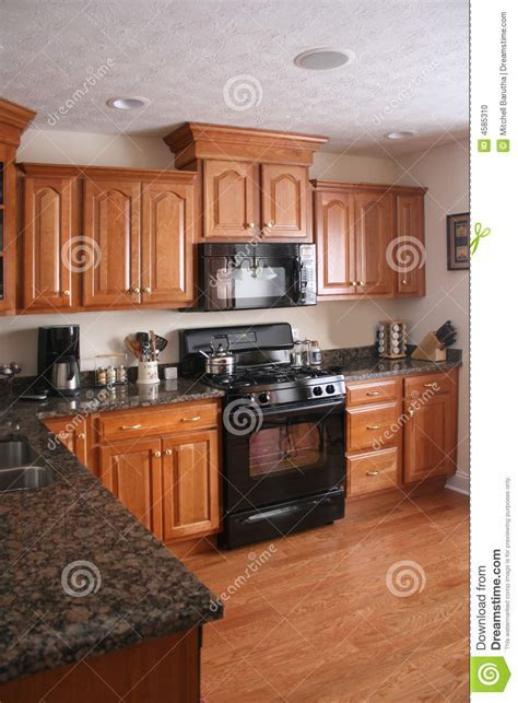 Kitchen Wood Cabinets Black Stove Stock Photo   Image: 4585310