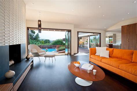 midcentury living room mid century modern fireplace dining room midcentury with glass dining table dowel leg chair
