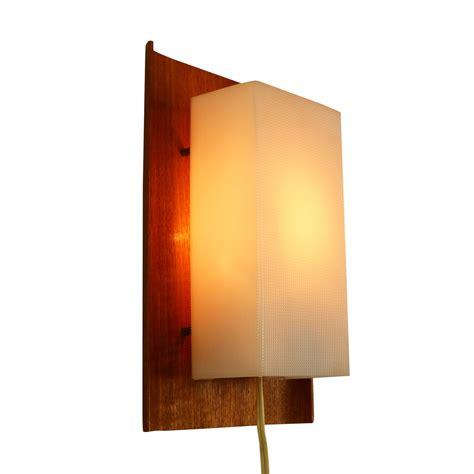 plastic wall scandinavian wall light from the sixties made of wood and