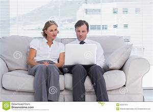 Business People Sitting On Couch And Using Laptop Stock ...