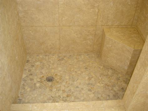 shower with 18 215 18 in porcelain tile with river rock shower