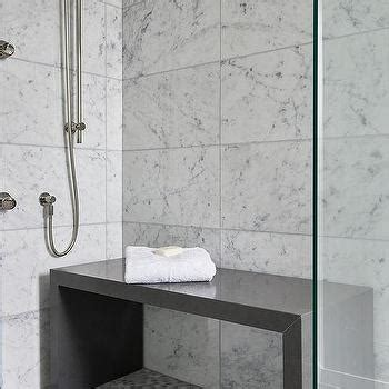 gray grid shower floor tiles  glass shower partition