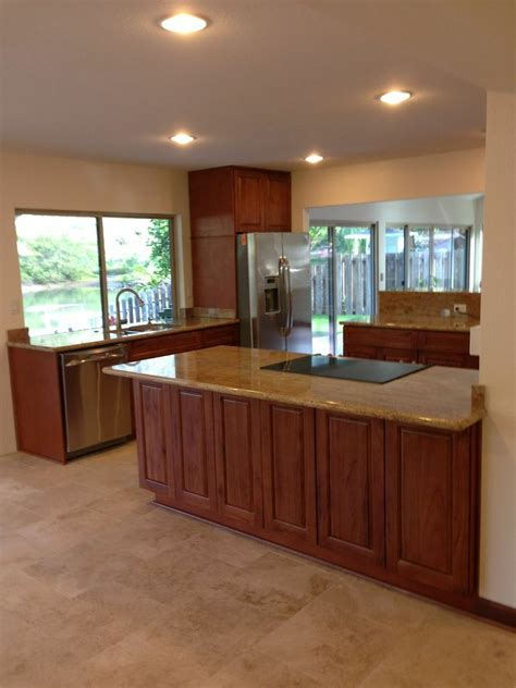 sunset cherry c c cabinets and granite