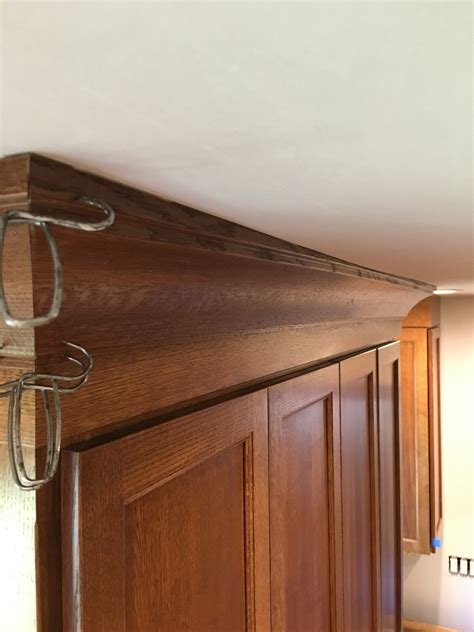 how to cut crown molding for kitchen cabinets hiding a wavy ceiling in crown molding homebuilding 9892