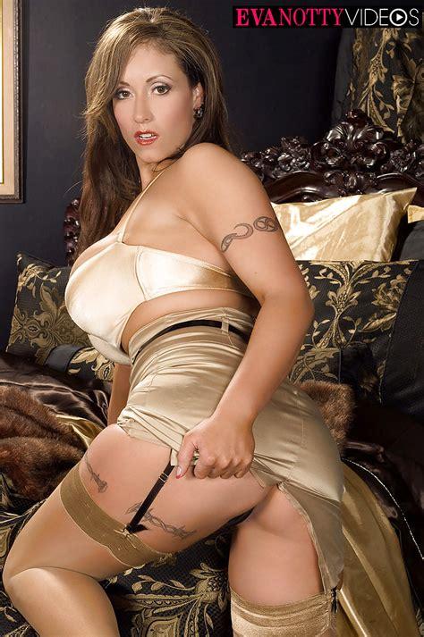 Busty MILF Eva Notty strips down to stockings and garters for masturbation - PornPics.com