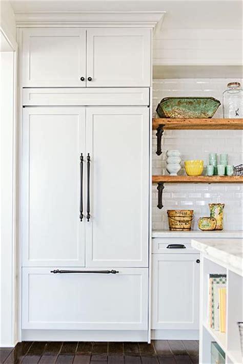 kitchen cabinets refrigerator panels a bright white kitchen redesigned online refrigerator