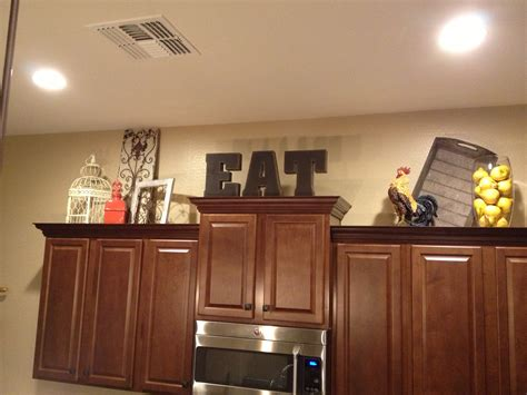 top of kitchen cabinet ideas 12 best ideas of top of kitchen cabinet decorating ideas